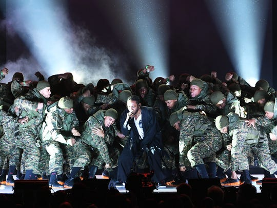 Kendrick Lamar (C) performs onstage during the 60th