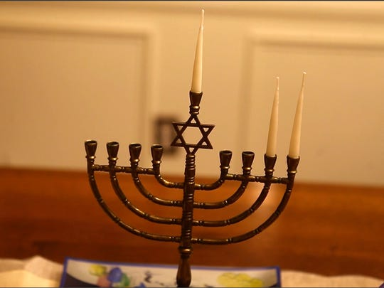 A menorah on on the dining room table at the Insinga's