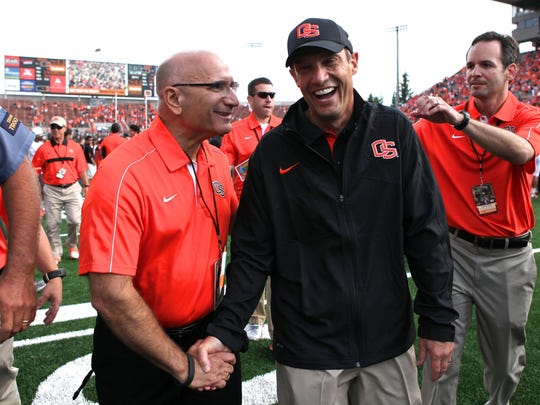 Oregon State athletic director Bob De Carolis (left) congratulates Beavers head football coach Mike Riley after a 10-7 win over Wisconsin Badgers at Reser Stadium to open the 2012 season.