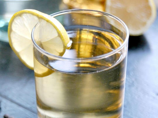 The Hot Metal Toddy blends rum, brandy, hot water and honey syrup.
