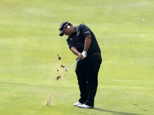 Kiradech Aphibarnrat of Thailand hits from the fairway during the first round of the 2017 WGC-HSBC Champions golf tournament at the Sheshan International Golf Club in Shanghai, China Thursday, Oct. 26, 2017. Kiradech Aphibarnrat dressed in black and played with purpose in the HSBC Champions. Black-clad citizens back home in Thailand solemnly ended a year of mourning for King Bhumibol Adulyadej with a series of traditional funeral ceremonies lasting five days. Kiradech opened with 10 birdies in Shanghai and was one shot off the lead. (AP Photo/Ng Han Guan)
