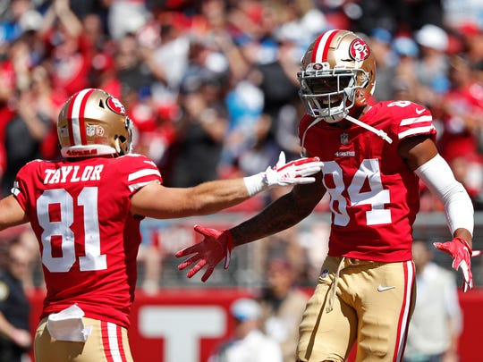 San Francisco 49ers wide receiver Kendrick Bourne celebrates with Trent Taylor (81) after scoring a touchdown during the first half of an NFL football game against the Detroit Lions in Santa Clara, Calif., Sunday, Sept. 16, 2018. (AP Photo/Tony Avelar)