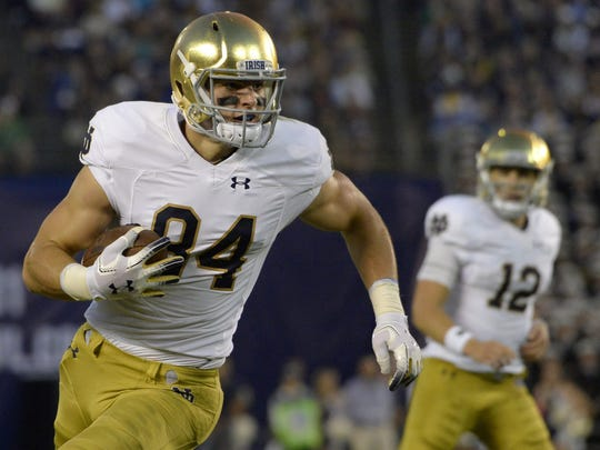 Notre Dame tight end Cole Kmet (84) runs after a catch against Navy during a 2018 game.