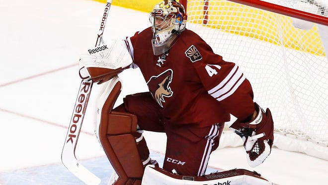 Arizona Coyotes goalie Mike Smith watches play against the Los Angeles Kings on Thursday, Dec.4, 2014, at Gila River Arena in Glendale.