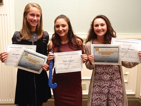 (left to right) Millburn's Megham Boehm, Ella Singer and Raquel Winer were honored at the the end of season banquet.