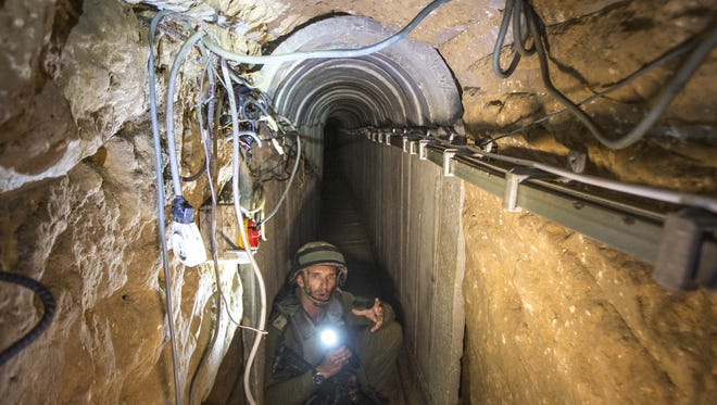 An Israeli army officer gives journalists a tour of a tunnel allegedly used by Palestinian militants for cross-border attacks, at the Israel-Gaza border.