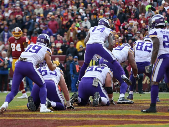 The Minnesota Vikings celebrate by playing leapfrog