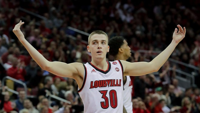 Louisville's Ryan McMahon pumps up the crowd after knocking down a three.