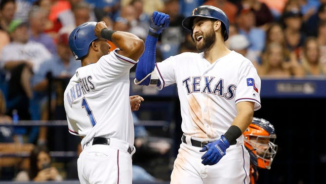 The Rangers' Joey Gallo is greeted at home by teammate Elvis Andrus after hitting a two-run home run during the  third inning against the Astros at Tropicana Field in St. Petersburg, Fla.