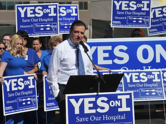 Dr. Benny Benzeevi speaks during the Yes on Measure I Save Our Hospital press conference in front of the Tulare Regional Medical Center tower on July 12, 2016.