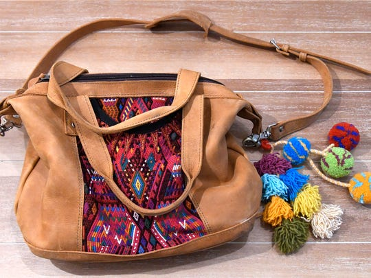 Stylemaker Christine Mueller swears by this Nena and Company purse decorated with poms from Noonday, two female owned companies. September 19, 2017