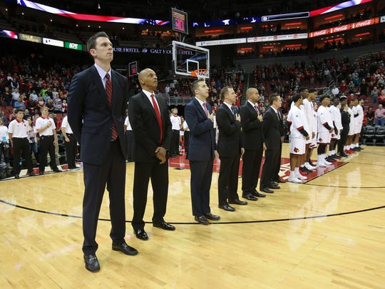 Louisville interim coach David Padgett, left, and his assistant coaches.