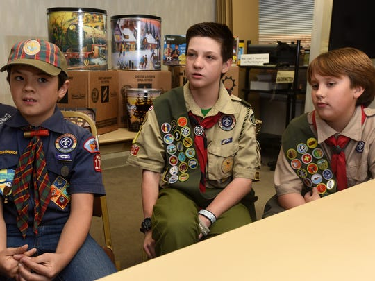 Dominic Burnham, 10, left, of Cub Scout Pack 179; Joe Paul, 12, of Boy Scout Troop 152; and Andrew Grobler, 12, of Boy Scout Troop 325, were the top sellers in the Anasazi District's annual popcorn fundraiser.