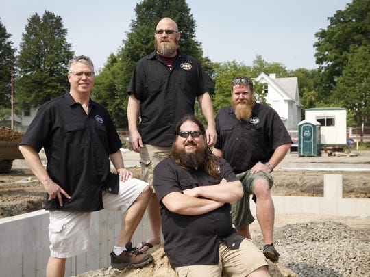 """The owners of Three Heads Brewing pose together on the site of their new brewery under construction at 186 Atlantic Ave in the city. They are, from left, Dan Nothnagle, Brian """"Skip"""" Johnson, Geoff Dale and Todd Dirrigl. The brewery is planning on opening in the first quarter of 2016."""
