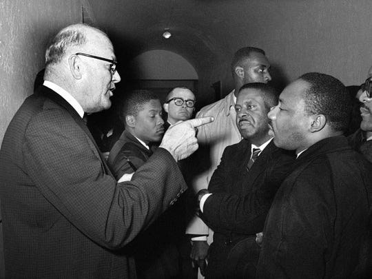 In this March 1, 1965, file photo, registrar Carl Golson shakes a finger at Dr. Martin Luther King Jr. during meeting at the courthouse in Hayneyville, Alabama.