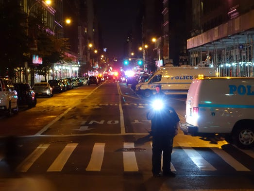 Police block a road after an explosion in New York