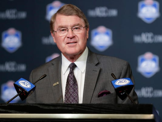Atlantic Coast Conference Commissioner John Swofford announces a 10-year contract extension with the Charlotte Sports Foundation to continue hosting the ACC Football Championship game in Charlotte during a news conference in Charlotte, N.C., Thursday, April 5, 2018. (AP Photo/Chuck Burton)