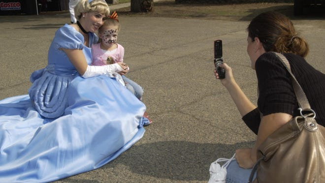 """Princesses are expected to appear in person for the Mother's Day Princess Tea Party 10 a.m. Saturday, May 7, at Mayors Park, Hall and West Main Street in Visalia.Pictured: Lisa Pace takes a picture of her daughter Kassidy Pace, 4, with """"Cinderella"""" during the Mooney Grove Park Centennial Celebration at Mooney Grove Park on Saturday, October 17, 2009."""