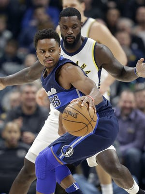 Dallas Mavericks guard Yogi Ferrell (11) spins around Indiana Pacers guard Lance Stephenson (1) in the first half of their game at Bankers Life Fieldhouse Wednesday, Dec. 27, 2017.