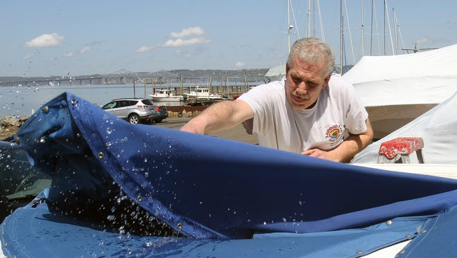 Mike Setteducati, manager of Tappan Zee Marina in Piermont, gets a boat ready for the season while at the marina May 1, 2014.