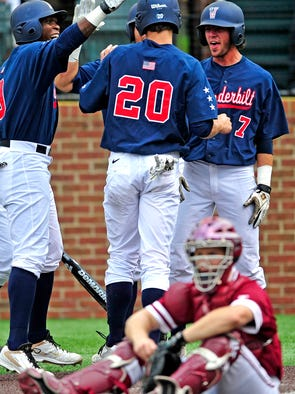 Vanderbilt's Bryan Reynolds (20) is congratulated by Dansby Swanson (7) and Xavier Turner after scoring on an error in the eighth inning of the Super Regional on Sunday at Hawkins Field in Nashville. Vanderbilt won 12-5 to advance to the College World Series.