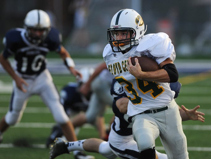 Floyd Central's Gaige Klingsmith (right) runs around the end for yardage against Providence on Friday at Providence High School. (By David Lee Hartlage, Special to the C-J) Aug. 29, 2014.