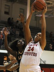 Wichita Falls High's Jada Jackson grabs the rebound in the 5-5A district matchup against Rider Tuesday, Dec. 13, 2016, at WFHS. The Lady Raiders defeated the Lady Coyotes 47-41.