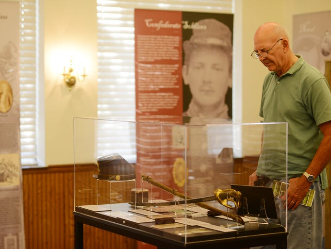 Sid Cisco, who is traveling from Sandusky, Ohio, stopped to see the traveling exhibition, Common People in Uncommon Times, at the Delta Heritage Center in Brownsville Thursday.