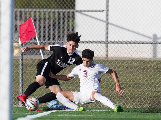 Veterans Memorial's Nicco Lopez and Calallen's Graysob Leal fight over the ball during the District 30-5A championship game at Cabaniss Soccer Field on Friday, Match 23, 2018.