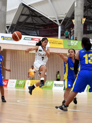 Guam womenÕs national basketball team starting point guard Jocelyn Pardilla throws a no-look pass as she drives down the lane in GuamÕs game against Nauru at the Taurama Aquatics Center and Indoor Sports Complex on Sunday. Guam won the game 116-25 at the 2015 Pacific Games in Port Moresby, Papua New Guinea and faces a tough home team in Papua New Guinea on Monday.