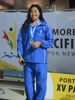 Guam's Pilar Shiimizu poses with her silver medal for her win in the 50-meter breaststroke at the Taurama Aquatics Center. Shimizu also unofficially broke the Guam record twice when she finished in 33.88 seconds in the preliminary races and again in the finals when she finished second at 33.35 seconds and earned her medal July 8 at the 2015 Pacific Games in Port Moresby, Papua New Guinea.