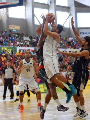 Guam men's national team member Tai Wesley goes strong to the basket during their game against Fiji at the Pacific Games in Port Moresby, Papua New Guinea. Guam won 78-61 and won its first gold medal in men's basketball since 1979.