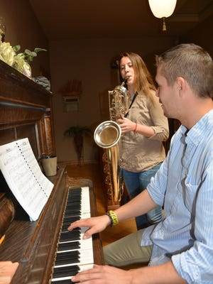 Elizabeth Truckey and Logan Dier practice for Elizabeth's performance in the Wisconsin Honors Band this week.