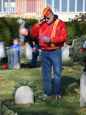 Matt Jordan of Vineland salutes as he reads the graveside Wreaths of Remembrance statement during the 2014 wreath-laying ceremony. This year's ceremony is set for 10 a.m. Saturday at Cumberland County Veterans Cemetery in Hopewell.