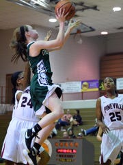 Menard's Maddie Smith (4) shoots against Pineville Wednesday at Pineville High School.