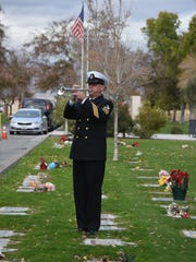 Taps is played during the funeral service for U.S. Navy Admiral Ben Montoya at the Coachella Valley Cemetery in Coachella on Wednesday, Jan, 6, 2016.