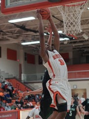 Mansfield Senior's Mario Young  goes up for a dunk
