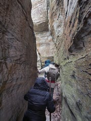 Hikers navigate some tight spaces during the Sweetheart