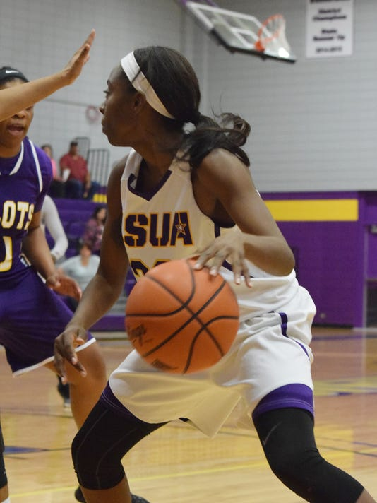 LSU of Alexandria's De'Shia Dillon (30) takes the ball in  against LSU of Shreveport Tuesday.