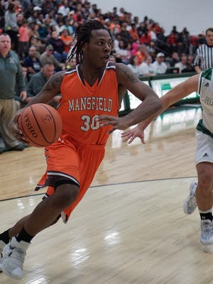 Mansfield Senior's Mario Young drives to the basket against Madison. Young is among the area's leaders in scoring, rebounds and steals.
