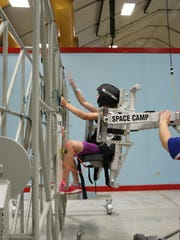 One of the Girl Scouts from Manitowoc, Olivia Valenta, experiencing the hands-on fun at Space Camp.