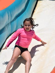 Delaney Halperin, 5, of Pittsgrove takes a ride on