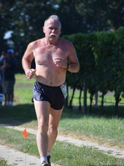 Virgil O'Brien of Millville races in the Run the Vineyards