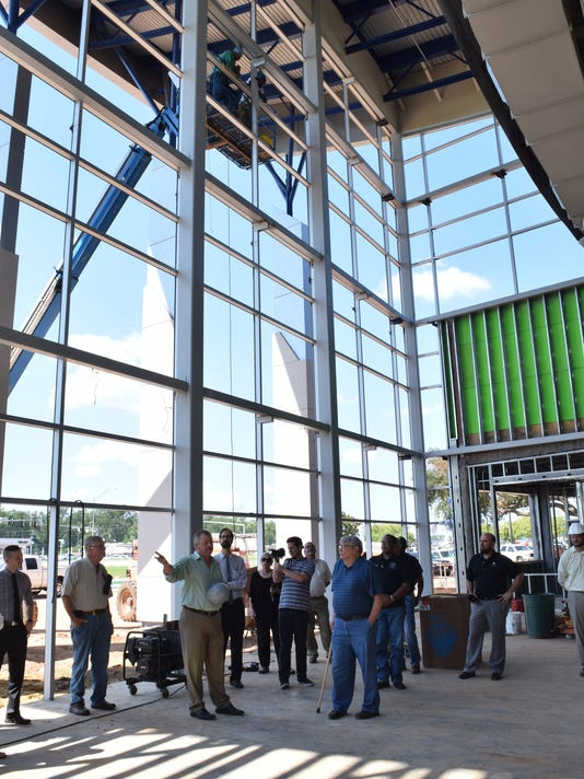 Bill Tudor of Alliance Design Group shows local dignitaries the main entrance to the Rapides Parish Coliseum which is still under construction. Tudor gave an update on the progress of the Rapides Parish Coliseum renovation project Wednesday while conducting a tour.
