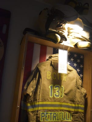 Justin Petrucelli's firefighter gear is displayed inside the gym at North Collier Fire's station 10.