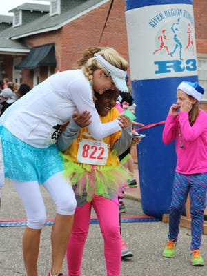 Girls on the Run River Region is open to 12 schools this spring. The 10-week program works to boost the self confidence in girls and prepares them to run a 5K.