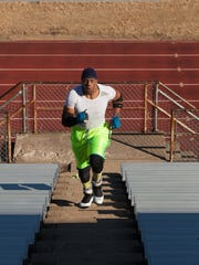 Anthony Eggleston runs up and down the bleachers at Arthur Halle Stadium.