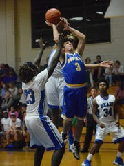 Buckeye's Chris Fuselier (3, right) goes for two against Bolton's Kevin Chambers (23, left).