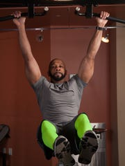 Kennis Sewell shows off his strength.
