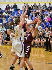 Southern Fulton's Drew Gordon looks to make a pass around Shanksville's Trista Stutzman during the District 5 Class 1A semifinal on Tuesday, Feb. 28, 2017 at Shanksville. The Vikings defeated Southern Fulton 47-38.